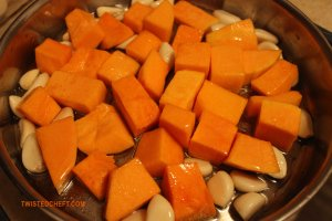 Garlic and Squash in an Oven-safe Pan