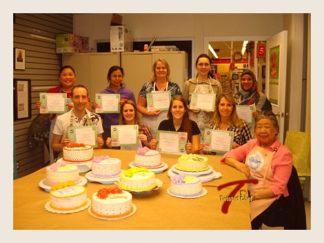 This is a picture of the whole class with our instructor. You can see all of the finished cakes and the participants with their certificates :)