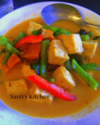 A Facebook Exclusive! Crispy tofu simmered in coconut milk, curry green paste by Santi of Santi's Kitchen. We carnivores do need to feed our herbivore friends and family. This is a great dish for just such a meal. I love the combination of Thai curry with coconut milk. Picture courtesy of Santi's Kitchen www.facebook.com/lmsmto